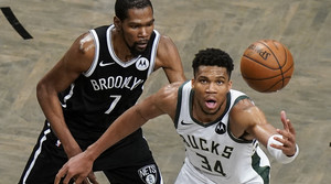 Brooklyn Nets' Kevin Durant defends against Milwaukee Bucks' Giannis Antetokounmpo.