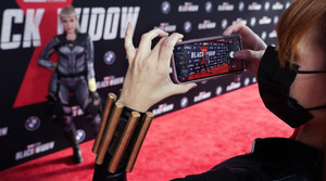 """""""Black Widow"""" fan Real Amanda Lynne, right, of Los Angeles, takes a picture of her friend Kat Fox"""