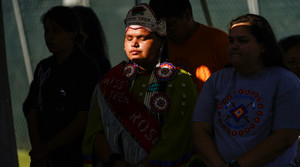 Young Native Americans mourning children who died at Indigenous boarding schools