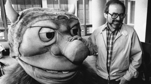 """author Maurice Sendak poses with one of the characters from his book """"Where the Wild Things Are""""."""