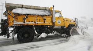 A plow clears a street in Wauwatosa, Wis.
