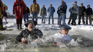 Two men jump into icy cold waters of Eagle Lake