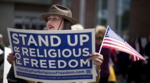Protester holds religious freedom sign