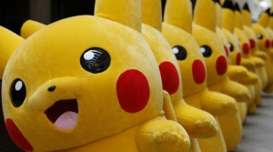 Dozens of Pokemon character Pikachu parade at a Japanese shopping district in 2016