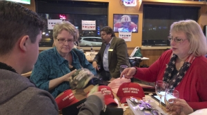 Supporters of Pres. Trump sell election merchandise