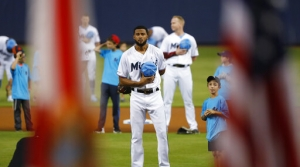 Miami Marlins starting pitcher Sandy Alcantara is shown during the singing of the National Anthem before the start of a baseball game