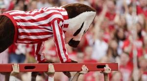Bucky Badger does push ups