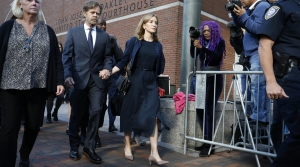 Felicity Huffman leaves federal court with her husband William H. Macy