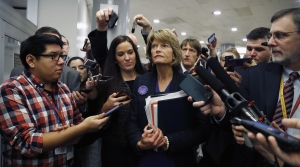 Sen. Lisa Murkowski, R-Alaska, walks with reporters as in the basement of the U.S. Capitol