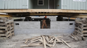 A Michigan house being lifted to save it from rising lake levels