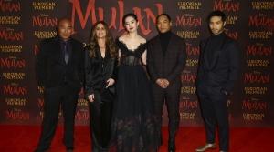 Actors pose at the European Premiere of 'Mulan' at a central London cinema