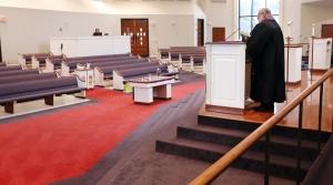 A preacher delivers a sermon to an empty church due to coronavirus outbreak