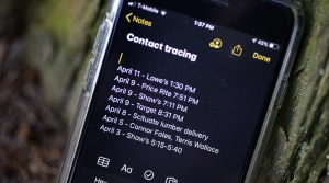 a smartphone with a list of places visited for contact tracing