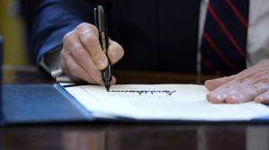 President Donald Trump signs coronavirus stimulus bill