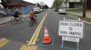 Bicyclists ride down streets closed to traffic during the pandemic.