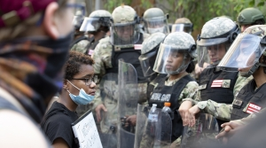 Protesters confront members of the National Guard