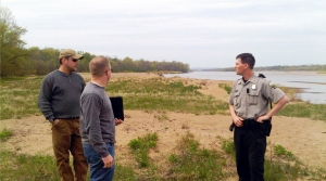 DNR managers and warden talking