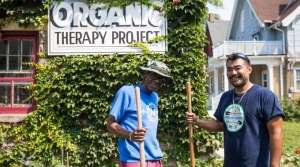 Brian Sales and a veteran work at a community garden in Milwaukee.