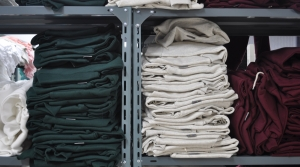 folded clothing on racks