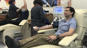 A doctor donates plasma to help COVID-19 patients
