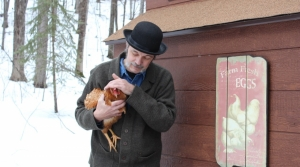 David Tank holding a chicken
