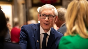 Governor Evers greets two women