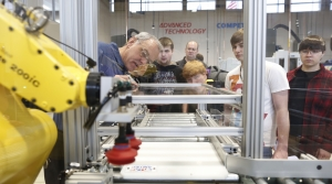 Staff and students look over machines at Gateway Technical College
