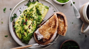 A plate of the herby kale omelette with manchego cheese.