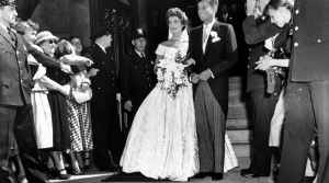 John F. Kennedy and Jacqueline Bouvier leave the church on their wedding day