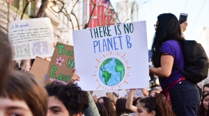 "person holding ""There is no Planet B"" sign"