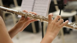 close-up of hands on a flute