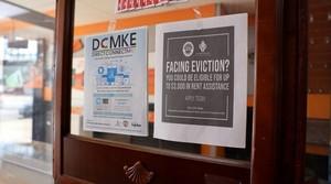 A rental assistance flier on store door in Milwaukee