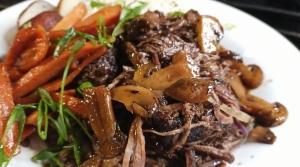 A close up photo of a plated pot roast