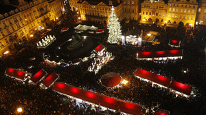 A Christmas tree illuminates the Old Town Square as the traditional Christmas market starts in Prague, Czech Republic.