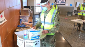 A member of the Wisconsin National Guard prepares a mobile vaccine clinic