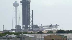 The SpaceX Falcon 9 is lowered at Kennedy Space Center, Fla.