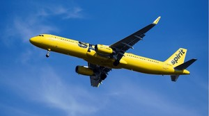 A Spirit Airlines jet in the sky