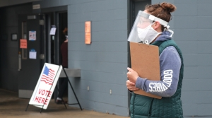 Poll worker waits for voters at drive-up location