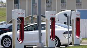 A Tesla car charges