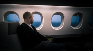 man on airplane sitting near window