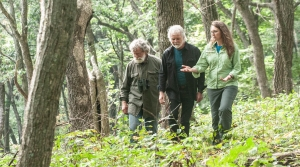 Chuck Leavell hikes through an oak forest with Ann Calhoun and Mike Mossman of the Nature Conservancy.