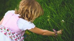 girl picking flower