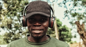Man smiling and wearing headphones