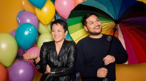 Tobin Low and Kathy Tu with balloons and umbrellas
