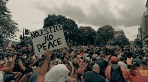 Protesters kneel during a Black Lives Matter demonstration