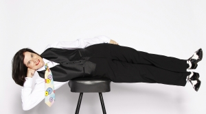 Paula Poundstone planking on a stool