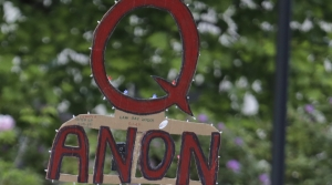 A QAnon sign at a rally