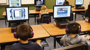 Children on computers in a classroom