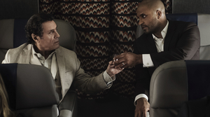 "an McShane, left, and Ricky Whittle in a scene from, ""American Gods."""