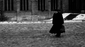 Woman walking alone in winter.